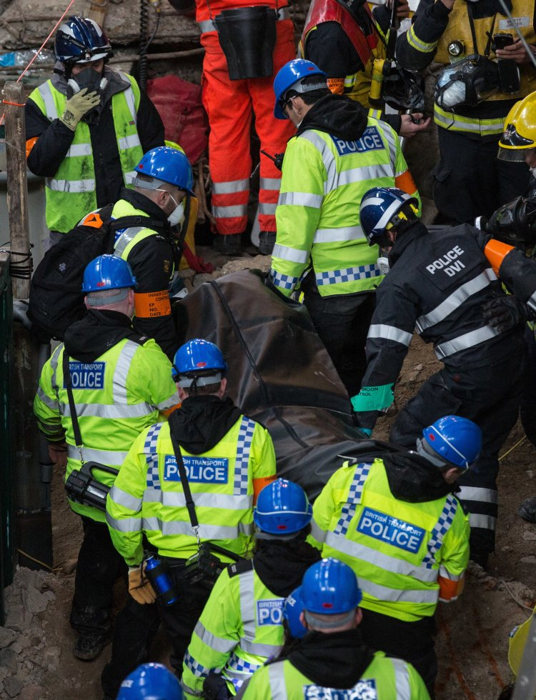 Emergency Service workers carry a fake corpse from the exercise area