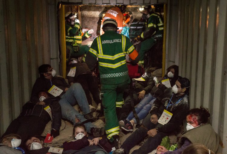 Emergency Service workers assess 'survivors' inside a simulated collapsed train platform