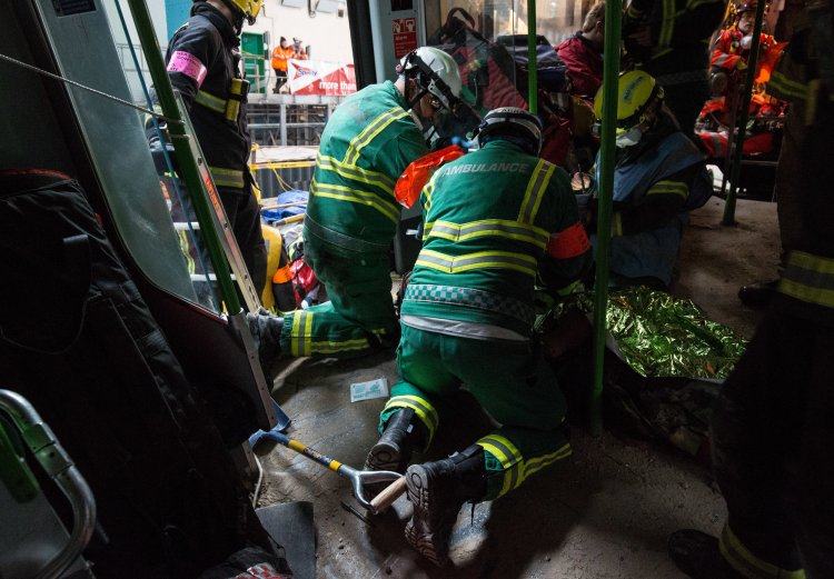Emergency service workers treat a 'survivor'