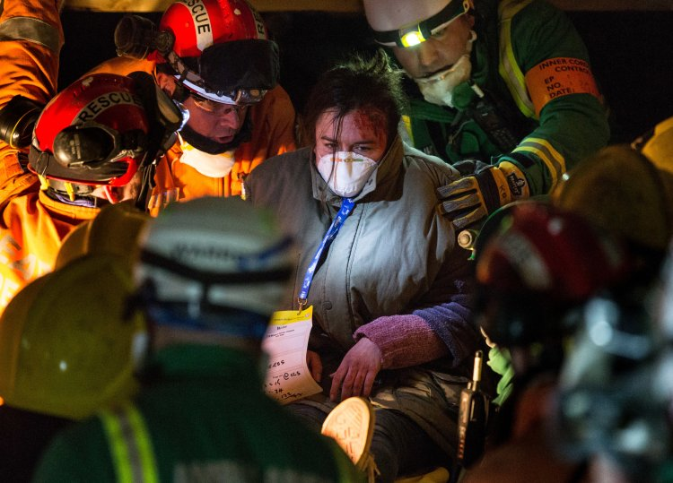 Emergency Service workers evacuate a 'survivor' from the exercise area