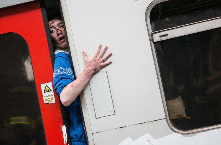 A 'survivor' tries to escape a destroyed London Underground train carriage