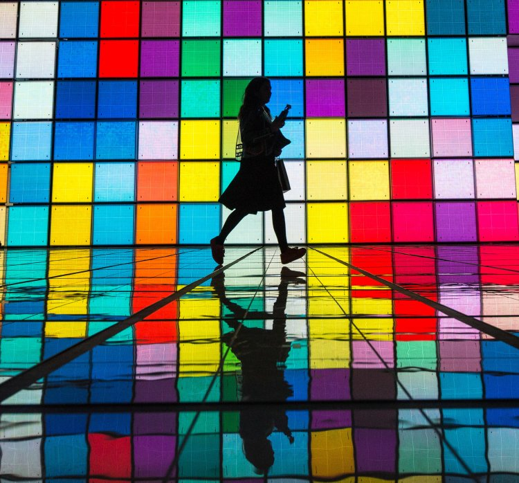 A woman run across the catwalk area after the Anya Hindmarch Show