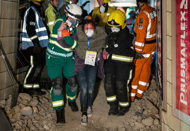 Emergency service workers evacuate a 'survivor' during 'Exercise Unified Response'