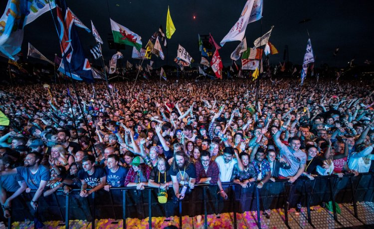 Crowd watching the Foo Fighters performing on the Pyramid Stage
