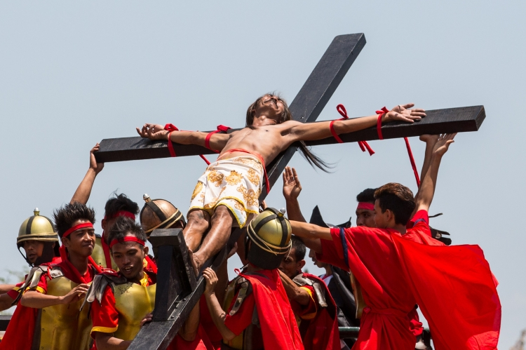 A Filipino penitent is nailed to a cross during Good Friday reenactments of the passion of Christ. The annual crucifixion rites draws huge crowds of people to San Fernando in northern Philippines