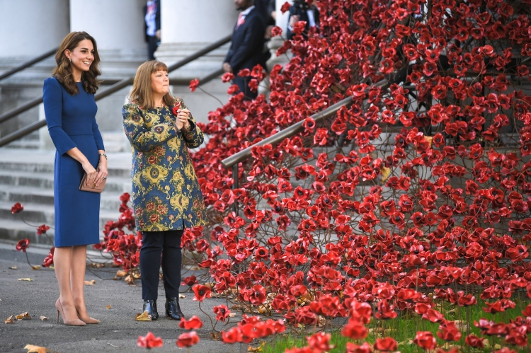 Catherine Duchess of Cambridge with the 'Poppies: Weeping Willow' artwork by Paul Cummins and Tom Piper