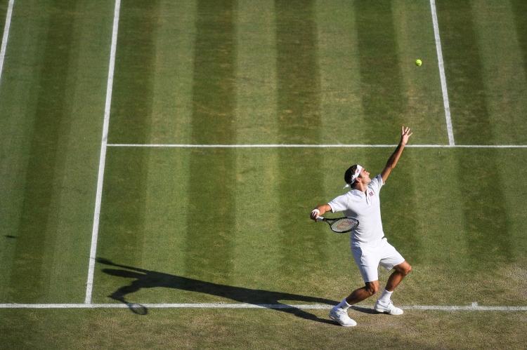 Roger Federer in action during his Gentlemen's Singles third round match