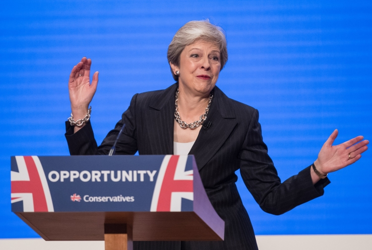 Theresa May dancing on stage