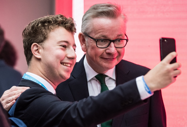 A delegate takes a selfie with Michael Gove